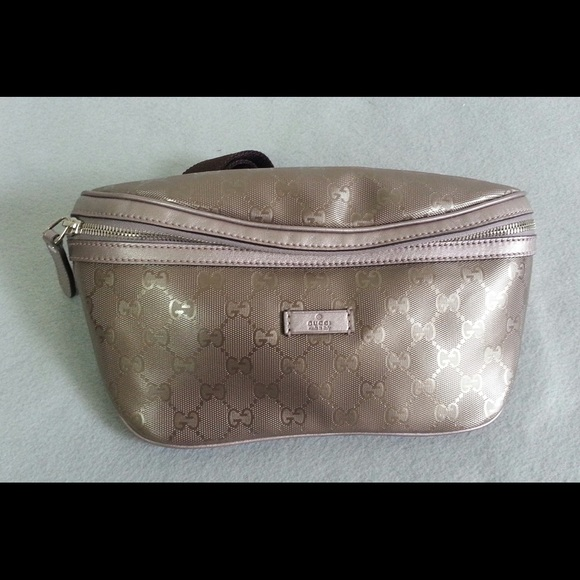 Gucci Handbags - NWT Authentic Gucci GG Plus Zip Belt Purse Bag